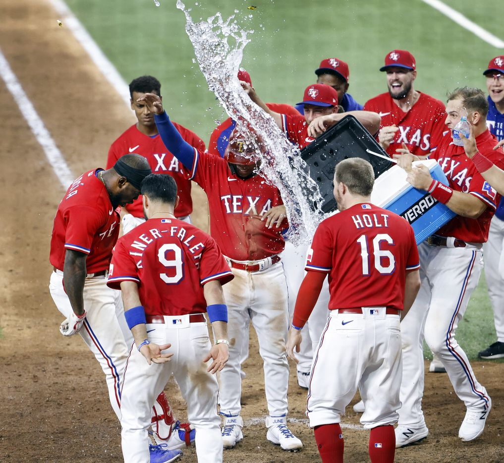 Texas Rangers batter Adolis Garcia (53) reacts after hitting a walk off 3-run homer in the tenth inning at Globe Life Field in Arlington, Texas, Friday, May 21, 2021. It was the first walk off home run in Globe Life Field history. (Tom Fox/The Dallas Morning News)