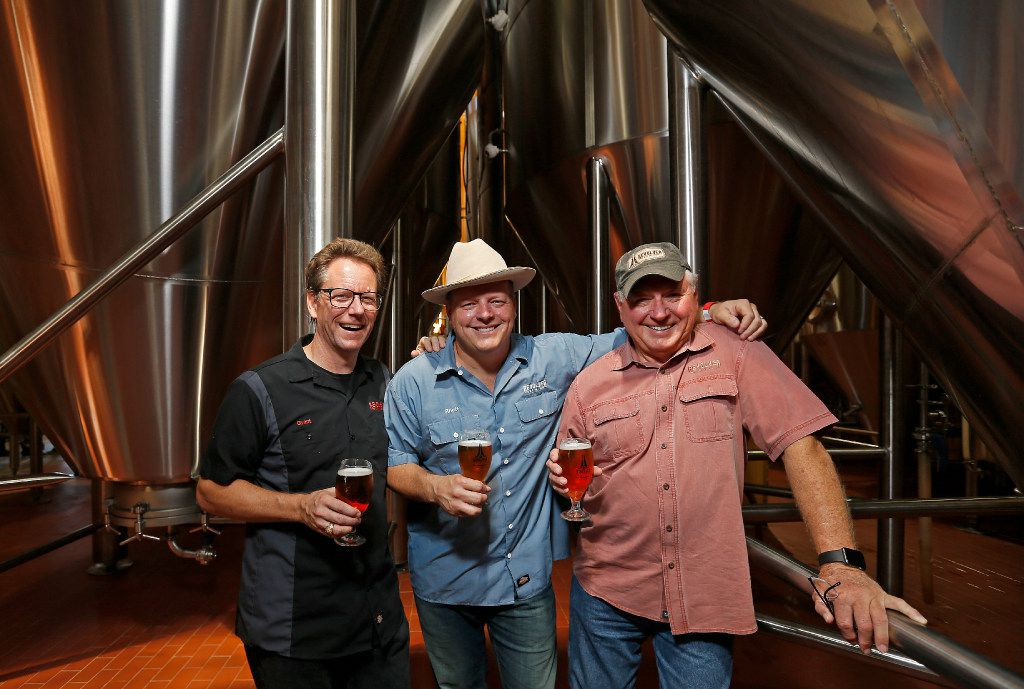 L to R, Brewmaster Grant Wood, founders Rhett and Ron Keisler of Revolver Brewing. The business in Granbury, Texas sold to MillerCoors earlier this year.