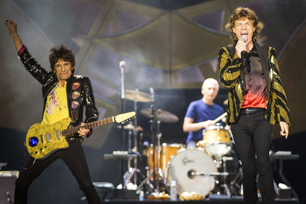 Mick Jagger (right), Ronnie Wood (left) and drummer Charlie Watts on stage at AT&T STadium