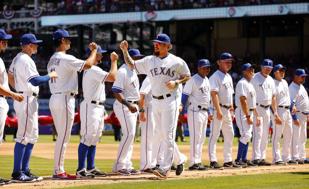 Texas Rangers left fielder Josh Hamilton (32) fist bumps teammates after being introduced during Opening Day ceremonies at Globe Life Park in Arlington, Monday, April 4, 2016. (Tom Fox/The Dallas Morning News)