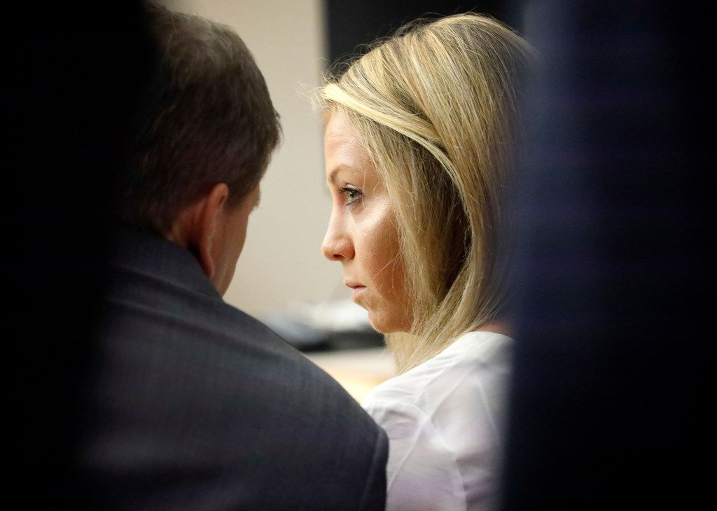 Amber Guyger listens to her attorney Toby Shook on Saturday in the 204th District Court at the Dallas County criminal courthouse.