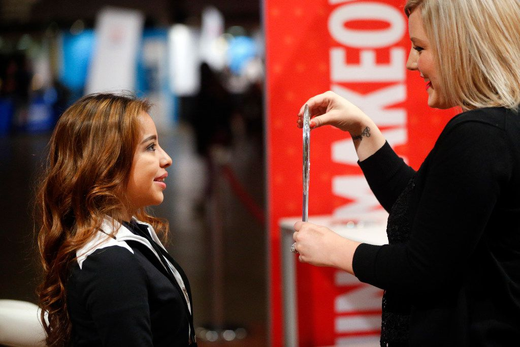 Job seeker Damaris Ramirez of Dallas had her makeup done as she sought advice on how to present herself to employers at the Opportunity Fair and Forum at the Kay Bailey Hutchison Convention Center in Dallas, Friday, May 19, 2017. (Tom Fox/The Dallas Morning News)