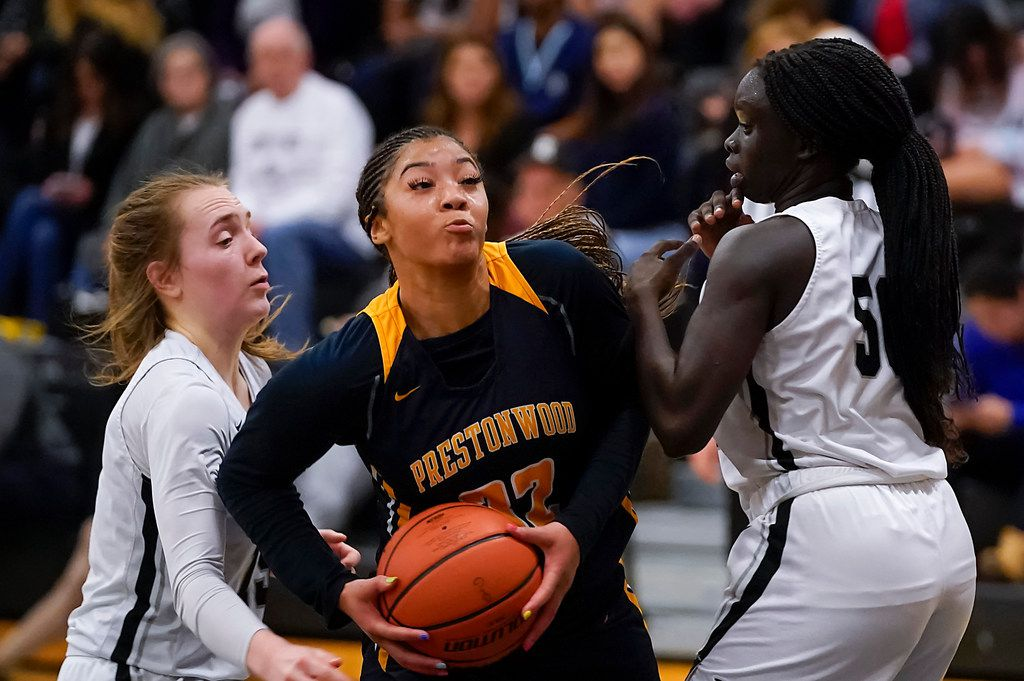 Prestonwood's Jordan Webster (center) drives to the basket in a game against Bishop Lynch this past season. (Smiley N. Pool/The Dallas Morning News)