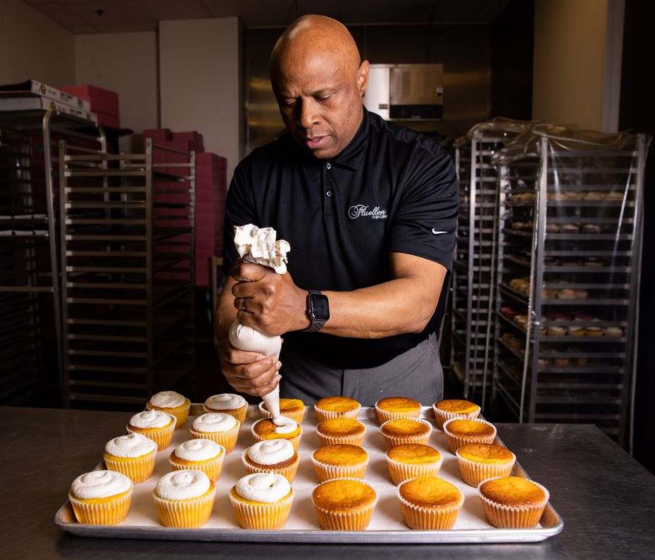 Owner Keith Fluellen frosts cupcakes at Fluellen Cupcakes in Dallas. Fluellen Cupcakes, a Black-owned small business, had to downsize during the pandemic to survive, and Fluellen had to take over chef duties.
