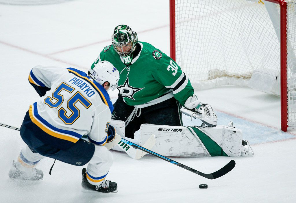 St. Louis Blues defenseman Colton Parayko (55) attempts a shot as Dallas Stars goaltender Ben Bishop (30) defends during the first period of an NHL hockey game game Friday, Nov. 29, 2019, in Dallas.