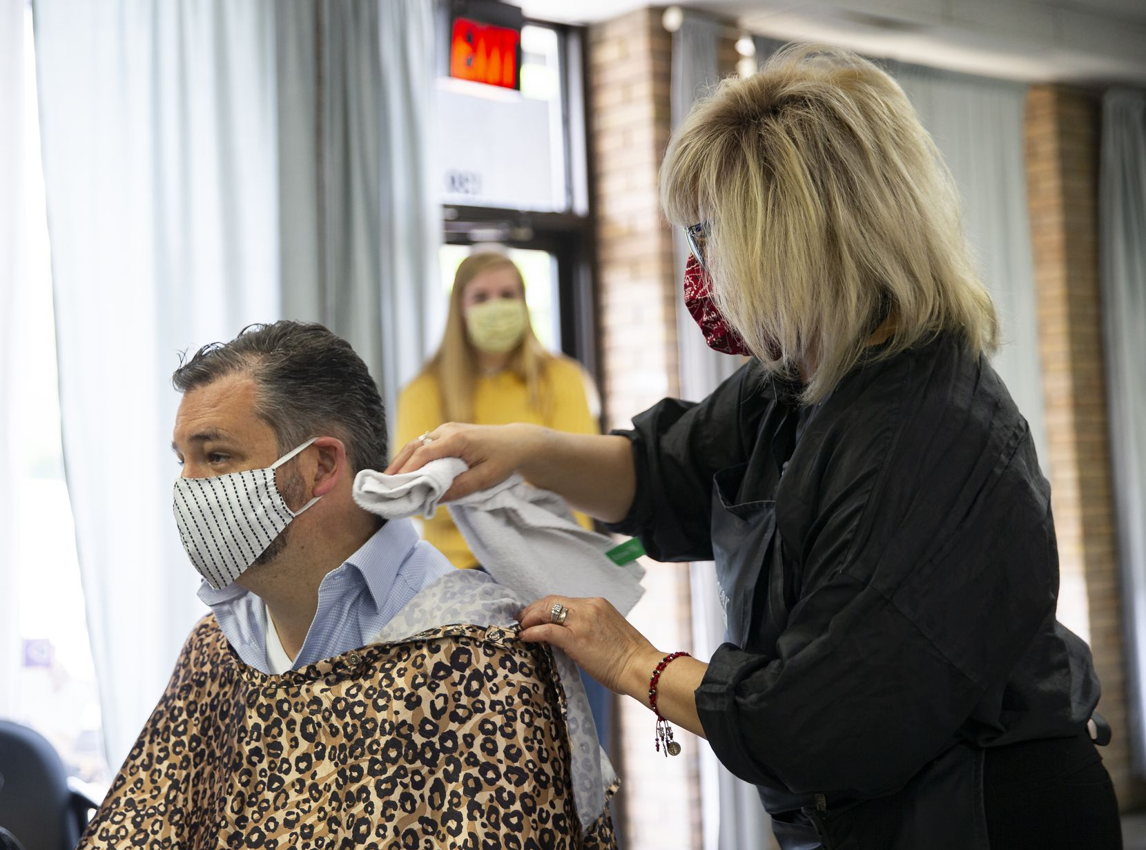 U.S. Sen. Ted Cruz, left, gets a haircut at Salon a la Mode on May 8, 2020 in Dallas. The Texas Supreme Court ordered salon owner Shelley Luther to be freed from Dallas County Jail Thursday. (Juan Figueroa/ The Dallas Morning News)