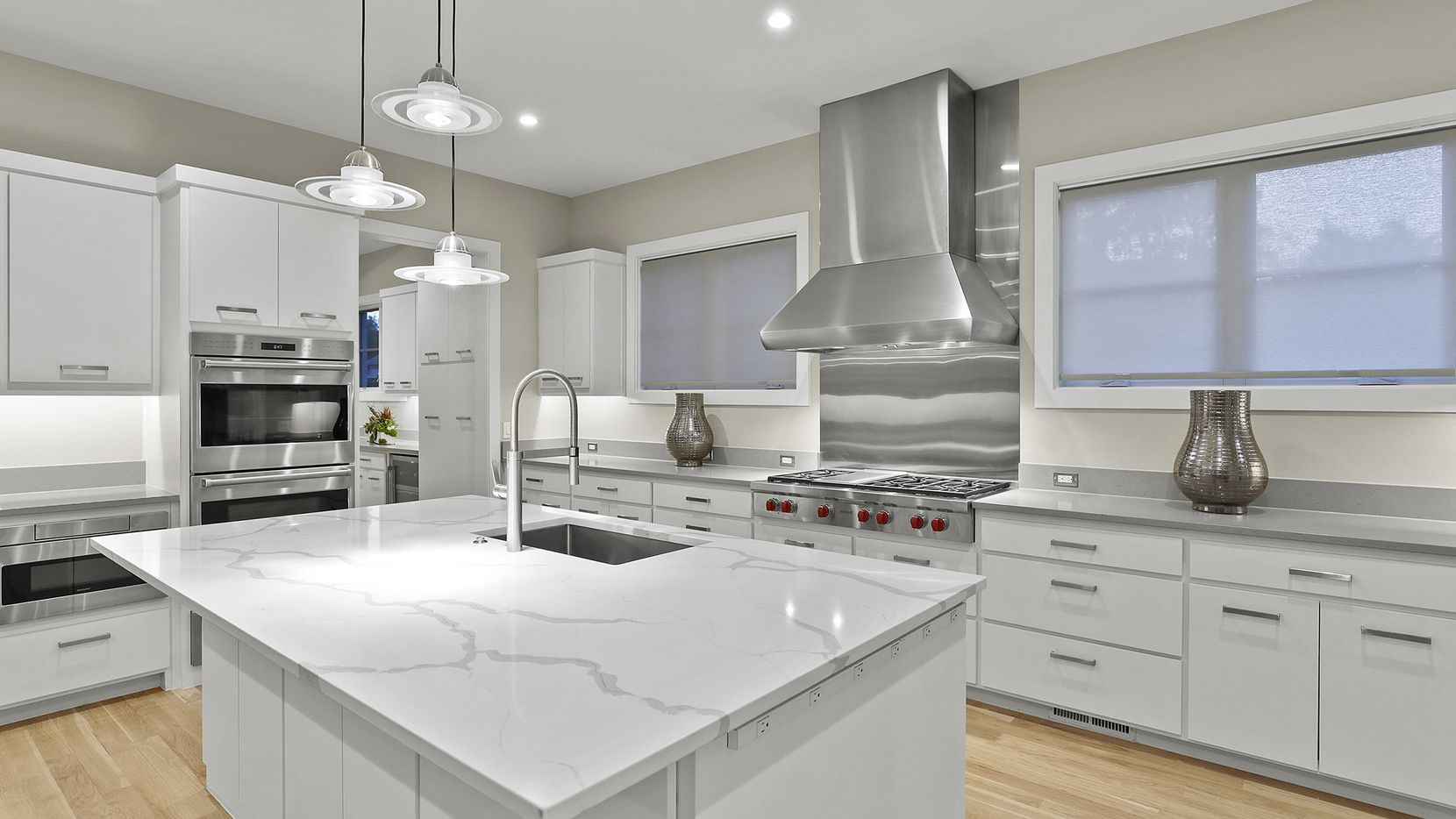 The newly constructed five-bedroom home at 4512 Mockingbird Lane in University Park includes a kitchen with stainless-steel appliances, white cabinetry and a large island.