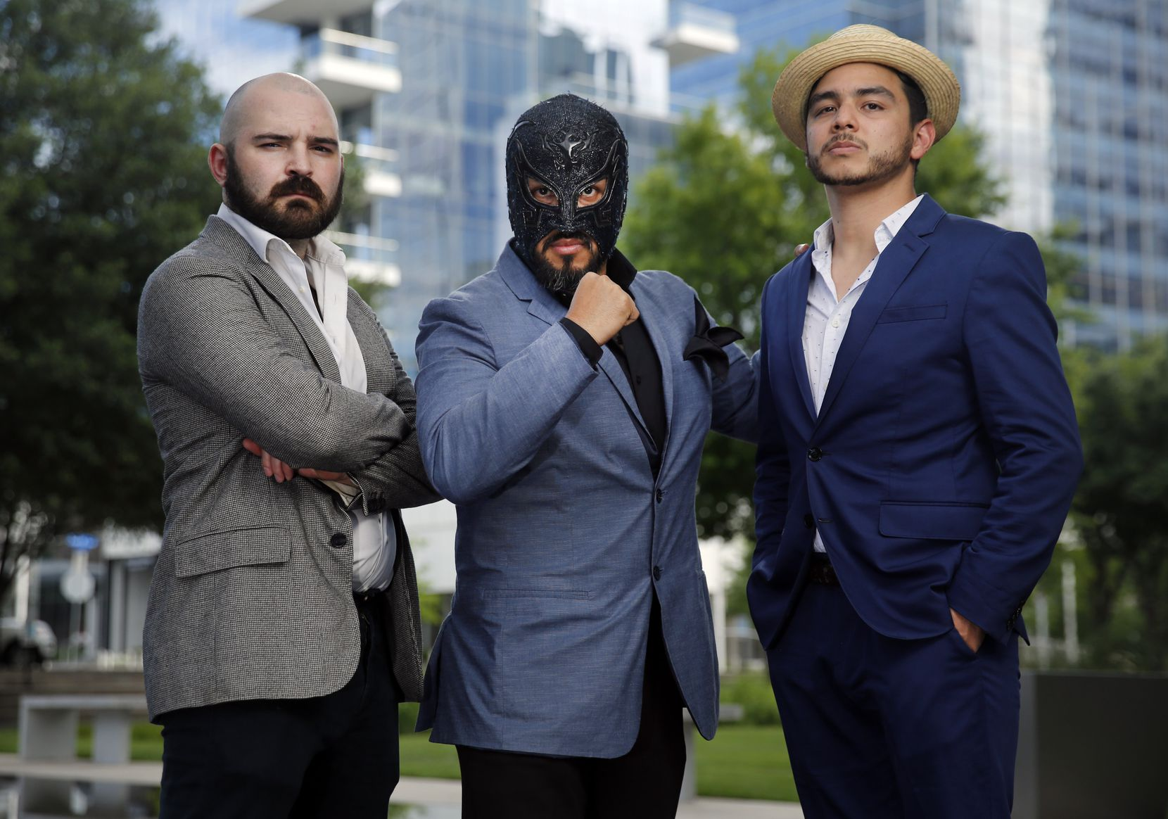 """""""Lucha Teotl"""" writer-directors Jeff Colangelo, left, and Chris Ramirez, far right, in the Dallas Arts District with fight coordinator Aski the Mayan Warrior, who has been wrestling on the """"lucha libre"""" circuit in the U.S. and abroad for 20 years."""