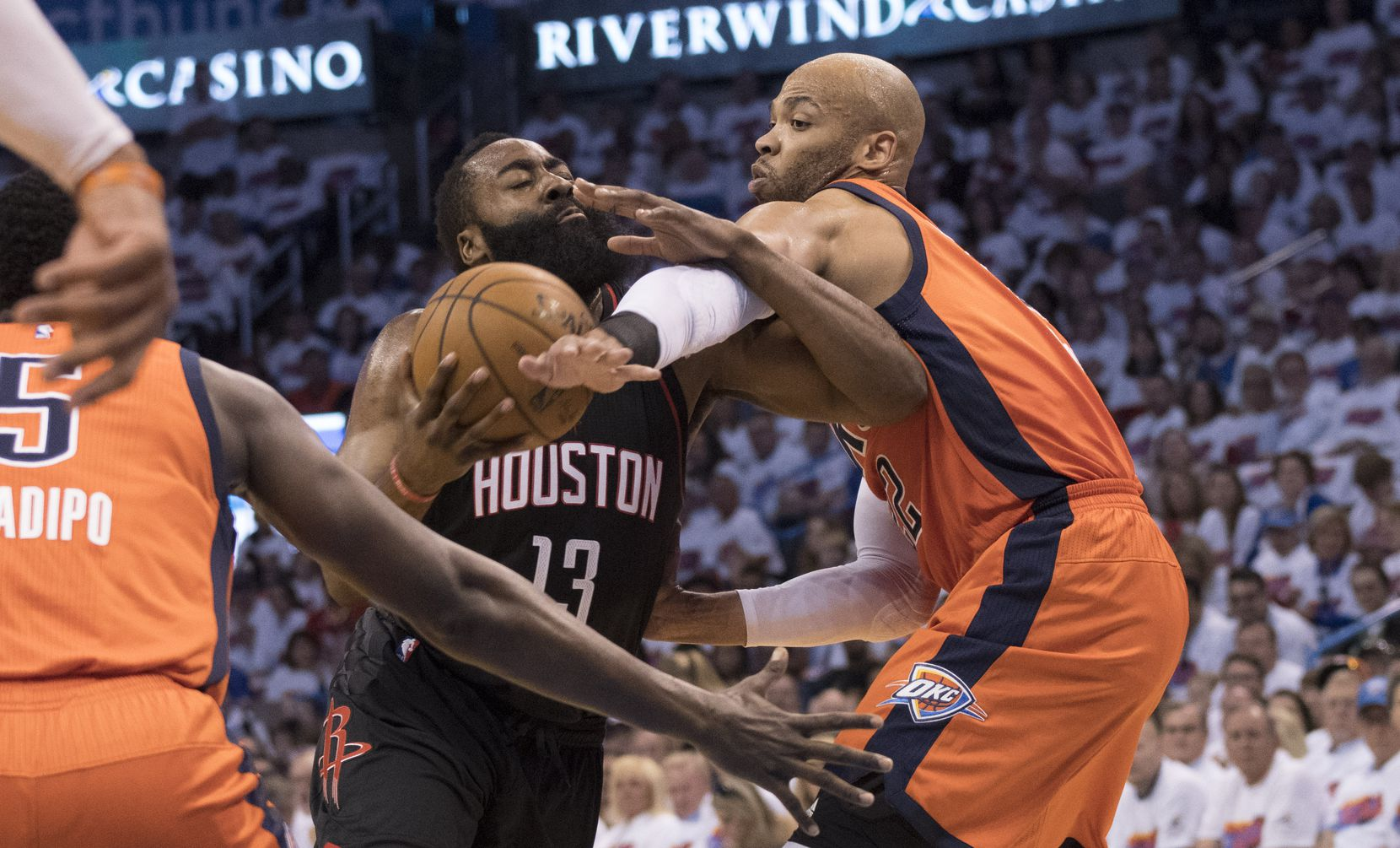 OKLAHOMA CITY, OK - APRIL 23: James Harden #13 of the Houston Rockets and Taj Gibson #22 of the Oklahoma City Thunder battle for the ball  during the first half of Game Four in the 2017 NBA Playoffs Western Conference Quarterfinals on April 23, 2017 in Oklahoma City, Oklahoma. Oklahoma City defeated Houston 115-113   NOTE TO USER: User expressly acknowledges and agrees that, by downloading and or using this photograph, User is consenting to the terms and conditions of the Getty Images License Agreement. (Photo by J Pat Carter/Getty Images)