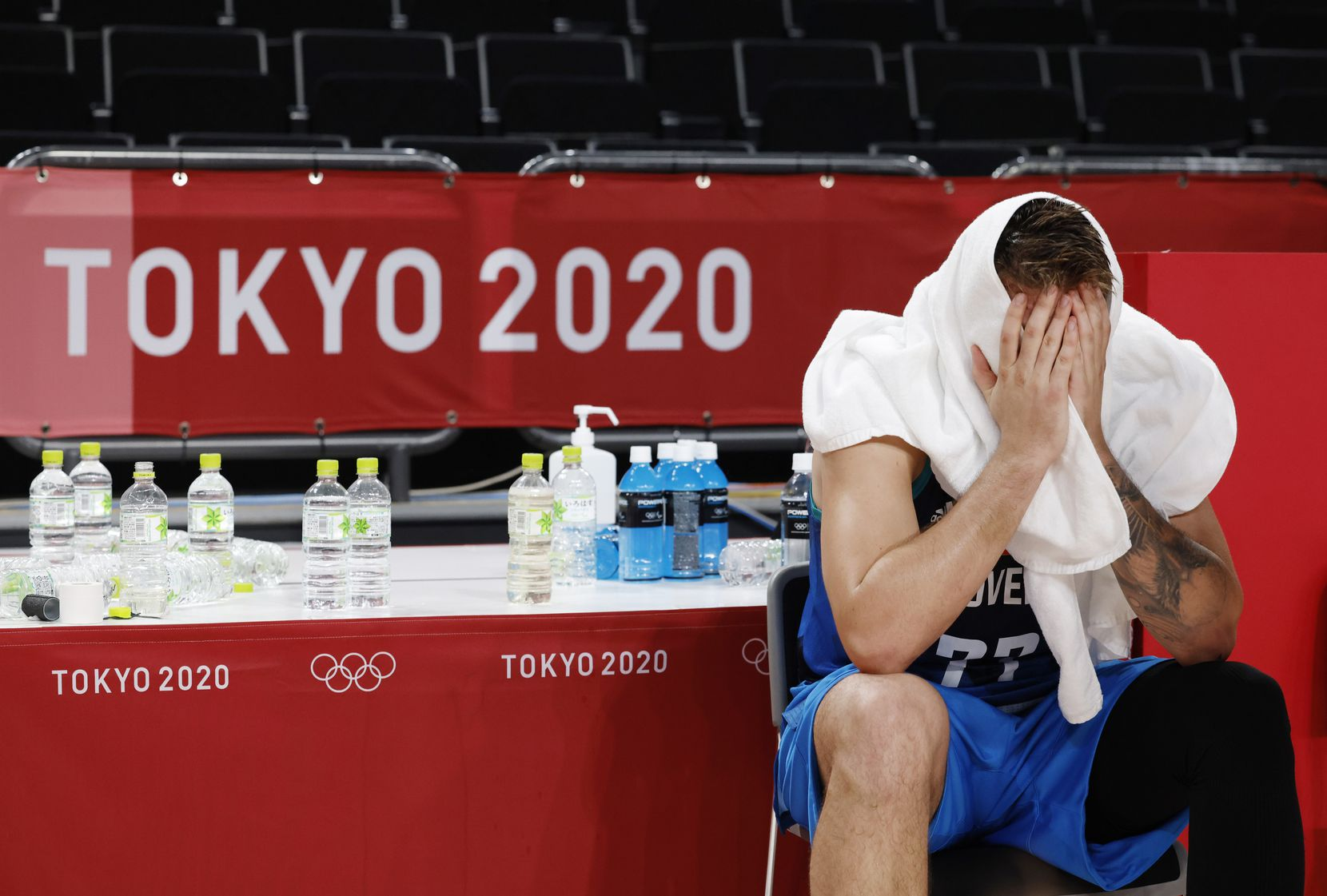 Slovenia's Luka Doncic (77) sits dejected after losing to France 90-89 in a men's basketball semifinal at the postponed 2020 Tokyo Olympics at Saitama Super Arena, on Thursday, August 5, 2021, in Saitama, Japan. France defeated Slovenia 90-89. Slovenia will play in the bronze medal game. (Vernon Bryant/The Dallas Morning News)