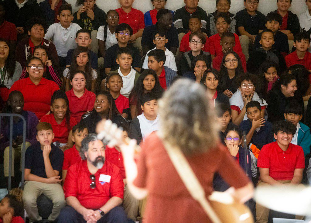 Erin O'Neill of the band Gooding performs at Bussey Middle School in Garland. The band alternated between playing music and talking about the basics of managing money.