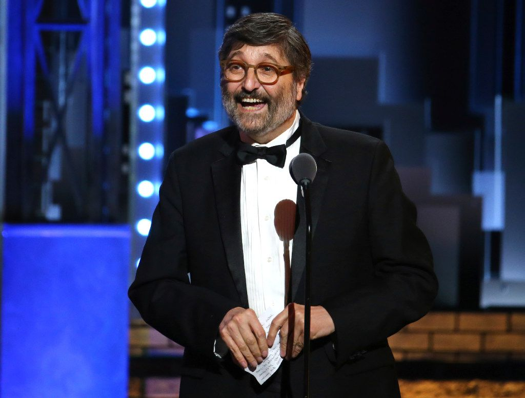 """Santo Loquasto accepts the award for best costume design of a musical for """"Hello, Dolly!"""" at the 71st annual Tony Awards on Sunday, June 11, 2017, in New York. (Photo by Michael Zorn/Invision/AP)"""