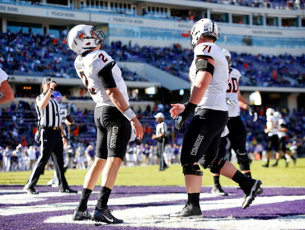 Oklahoma State Cowboys quarterback Mason Rudolph (2) yells after scoring a fourth quarter touchdown against the TCU Horned Frogs at Amon Carter Stadium in Fort Worth, Saturday, November 19, 2016. TCU lost, 31-6. (Tom Fox/The Dallas Morning News)
