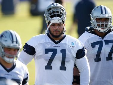 Dallas Cowboys offensive tackle La'el Collins (71) and Dallas Cowboys offensive tackle Tyron Smith (77) watch a drill in progress during the first day of training camp at Dallas Cowboys headquarters at The Star in Frisco, Texas on Friday, August 14, 2020.