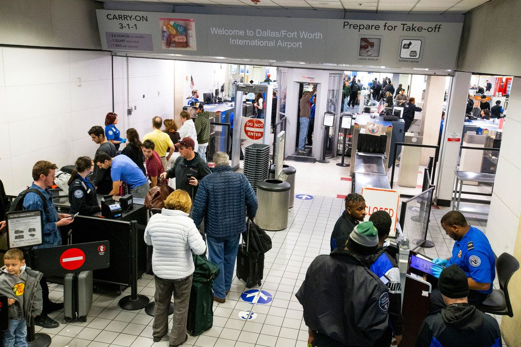 Travelers make their way through DFW International Airport terminal C security on Friday, Dec. 21, 2018. Terminal C is the only terminal of the original four that has not been recently updated. As a result it is crowded and has the most dated layout.  (Shaban Athuman/The Dallas Morning News)