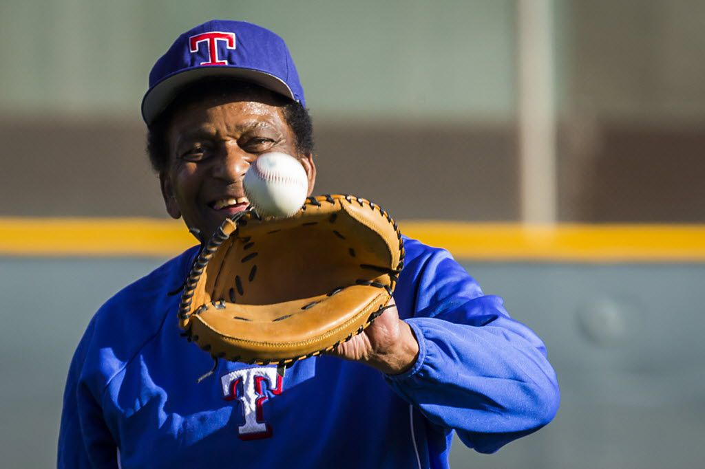 Country music singer Charley Pride plays catch during a spring training workout at the Texas Rangers training facility on Tuesday, Feb. 23, 2016, in Surprise, Ariz.