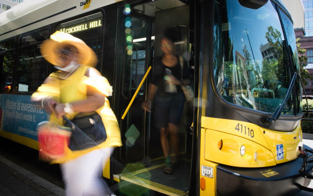 People exit a DART bus in downtown Dallas on Monday, July 10, 2017. (Tailyr Irvine/The Dallas Morning News)