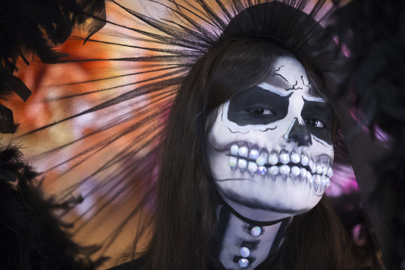 Model Brittney Martinez is styled as a traditional Catrina in a 1840's dress at a Día de los Muertos celebration at the Latino Cultural Center in Dallas on Saturday, October 27, 2018. People took pictures and selfies with Martinez. (Daniel Carde/The Dallas Morning News)