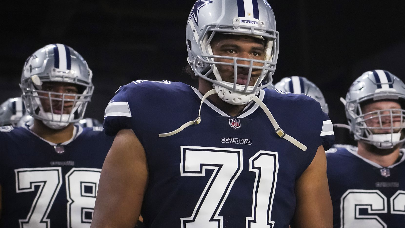 Dallas Cowboys offensive tackle La'el Collins (71) waits to take the field before an NFL football game against the Tampa Bay Buccaneers at Raymond James Stadium on Thursday, Sept. 9, 2021, in Tampa, Fla.