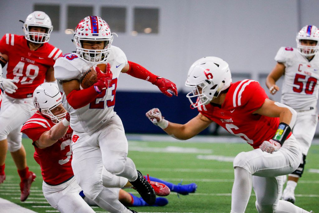 Parish Episcopal running back Christian Benson (23) fails to evade the Houston St. Thomas defense in the first quarter of a TAPPS Division I state semifinal game at the Star in Frisco, on Saturday, November 30, 2019. Parish Episcopal leads 21-7 at halftime. (Juan Figueroa/The Dallas Morning News)