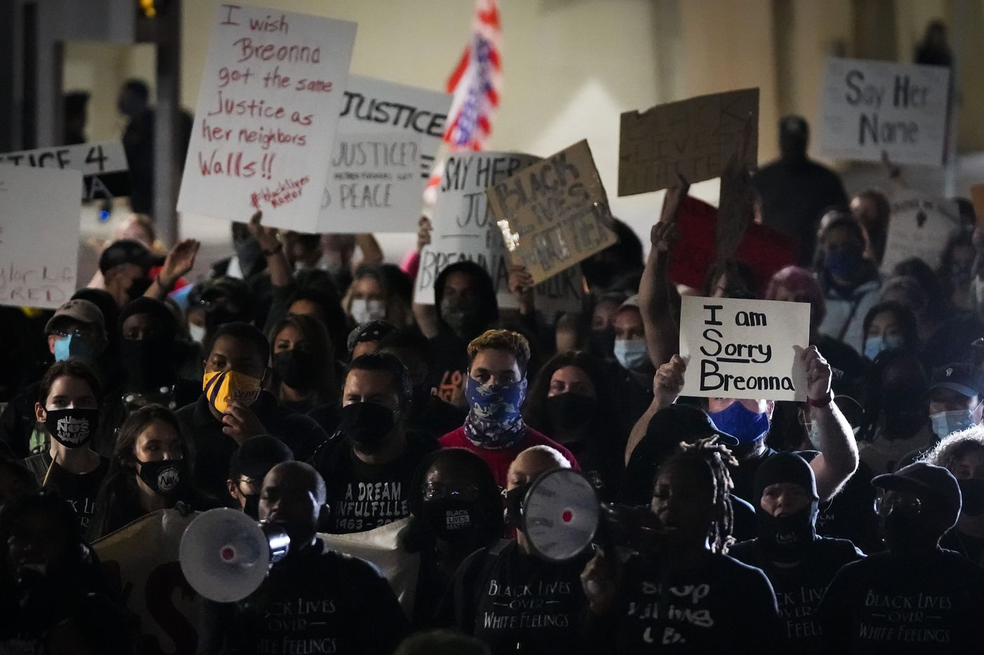 Demonstrators march on Ervay Street near Dallas City Hall after after a Kentucky grand jury brought no charges against Louisville police for the killing of Breonna Taylor on Wednesday, Sept. 23, 2020.