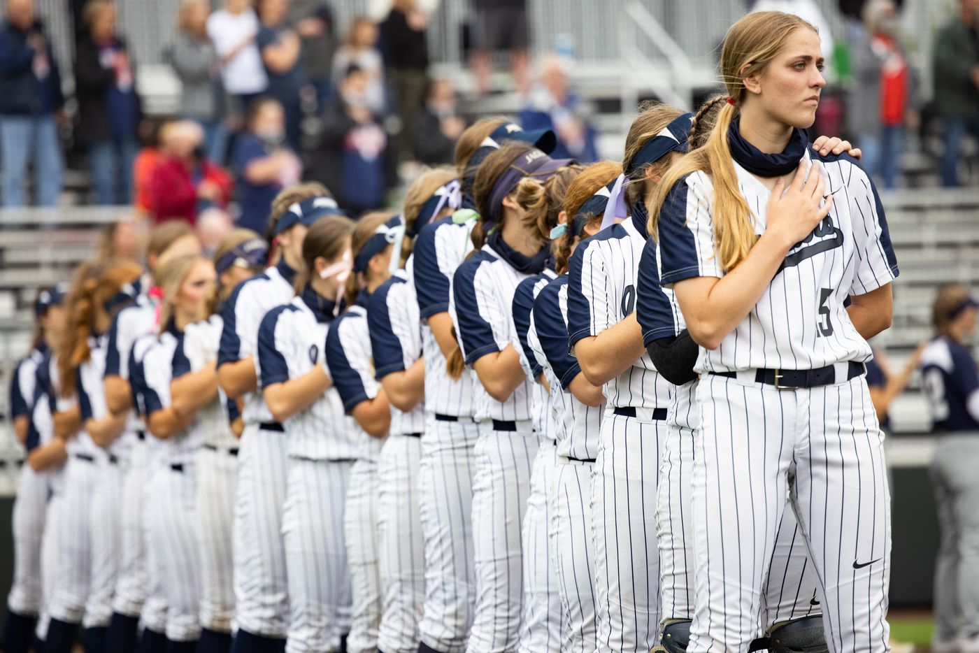 Flower Mound's pitcher Landrie Harris (15) stands with her team during the national anthem before a softball Class 6A bi-district playoff game against McKinney Boyd on Friday, April 30, 2021, in Denton. (Juan Figueroa/The Dallas Morning News)