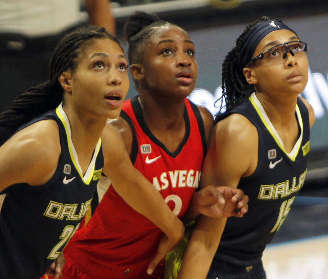 Las Vegas guard Jackie Young (0), center, is framed by Dallas Wings forward Isabelle Harrison (20), left, and Allisha Gray (15) as the trio are poised to position themselves for a rebound during second half action. Las Vegas defeated Dallas 95-79. The two WNBA teams played their game at College Park Center on the campus of UT-Arlington on July 11, 2021. (Steve Hamm/ Special Contributor)
