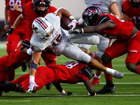 McKinney Boyd running back Carter Whitefield (15) gets tripped up by Denton Braswell defensive back Ayoub Githii (48) during the first half in a District 5-6A high school football game played at the C.H. Collins Complex on Friday, Sept. 24, 2021, in Denton.
