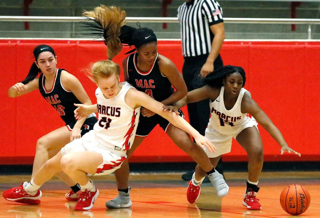 Irving MacArthur High School forward Morgan Browning (4) tries for a loose ball between Flower Mound Marcus High School forward M.J. Jefferson (14) and Flower Mound Marcus High School guard Olivia Fredrick (4) uring the first half as Flower Mound Marcus High School hosted Irving MacArthur High School in a girls basketball game in Flower Mound on Tuesday, January 14, 2020. (Stewart F. House/Special Contributor)