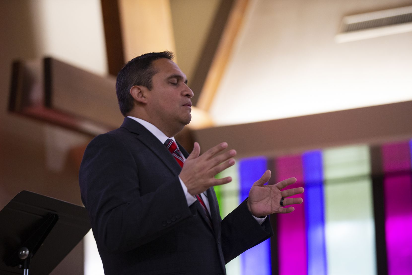 Pastor Ricardo Brambila led his congregation in prayer in First Mexican Baptist Church's new location Sunday — its first service in the former John Calvin Presbyterian Church after October's tornado, which destroyed Brambila's house of worship.