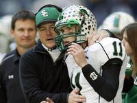 ORG XMIT: *S18F42EBC* Southlake Carroll's head coach Todd Dodge congratulates his son and quarterback Riley Dodge (11) after Riley through a touchdown in a game against Colleyville Heritage during the second half of play of a high school football playoff game at Texas Stadium in Irving on Saturday, December 9, 2006. Carroll defeated Heritage 33-7. 12132006xQUICK 12162006xSports