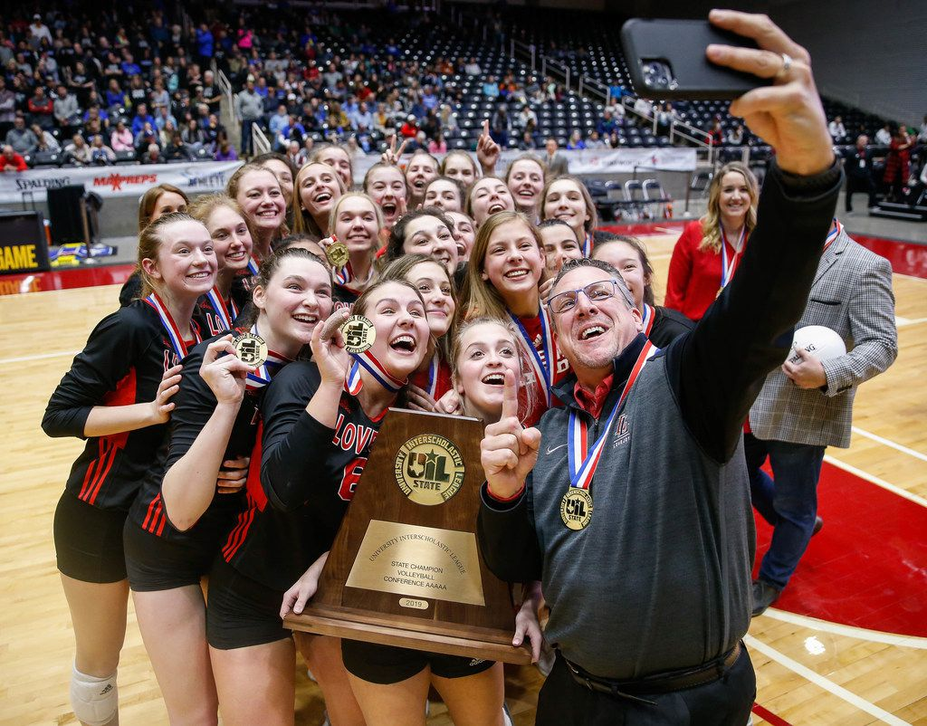 The Lucas Lovejoy Leopards pose for a selfie after winning a class 5A volleyball state semifinal match against Canyon Randall at the Curtis Culwell Center in Garland, on Saturday, November 23, 2019. Lovejoy won all three sets 27-25, 25-17 and 25-15. (Juan Figueroa/The Dallas Morning News)