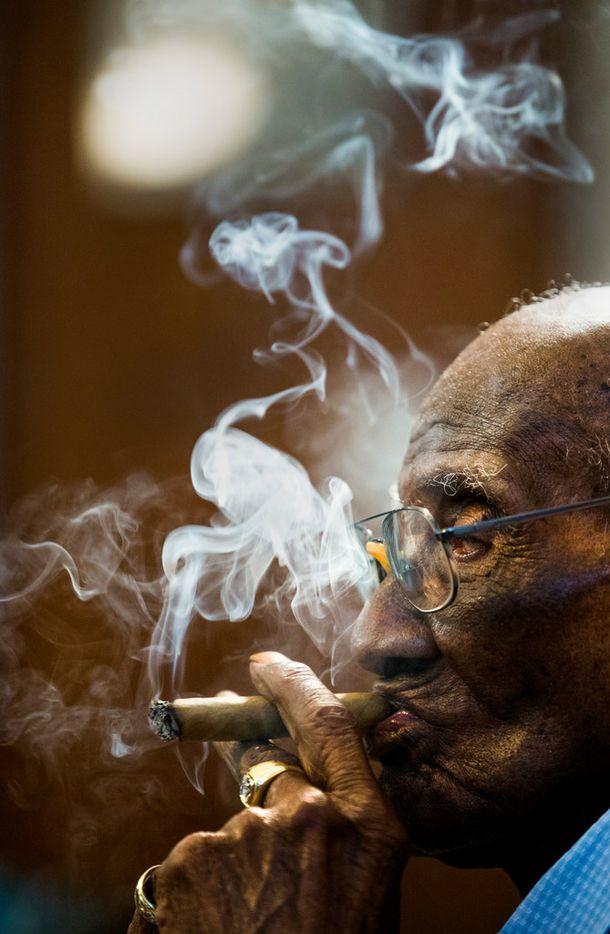 U.S. Army veteran Richard Overton smokes a cigar.