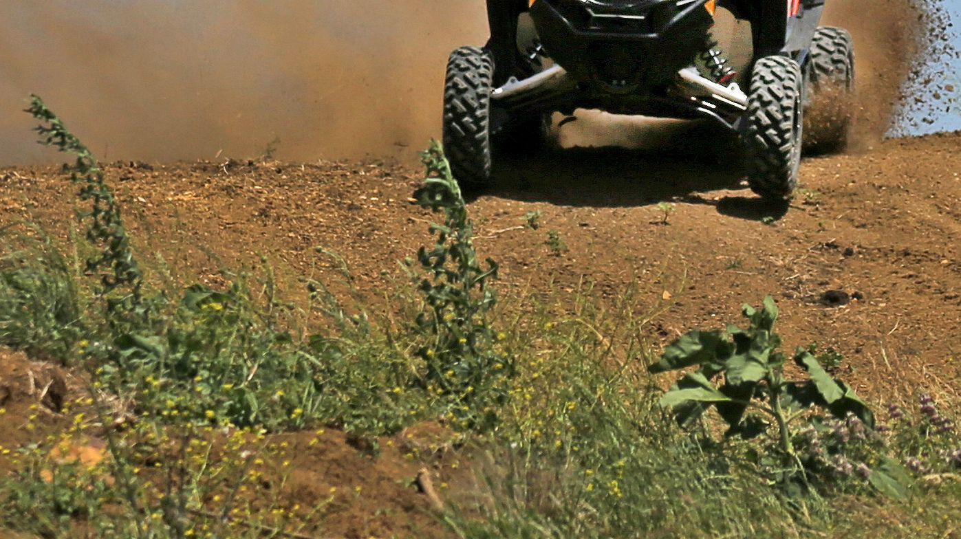 An ATV drives through dirt in an undated photo.