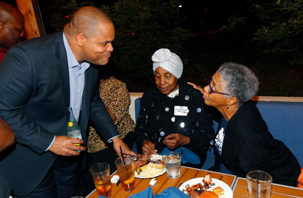 Dallas mayoral candidate and current state Rep. Eric Johnson visited with his mother, Alice Johnson, (right) during an election night party at Smoky Rose restaurant in Dallas.