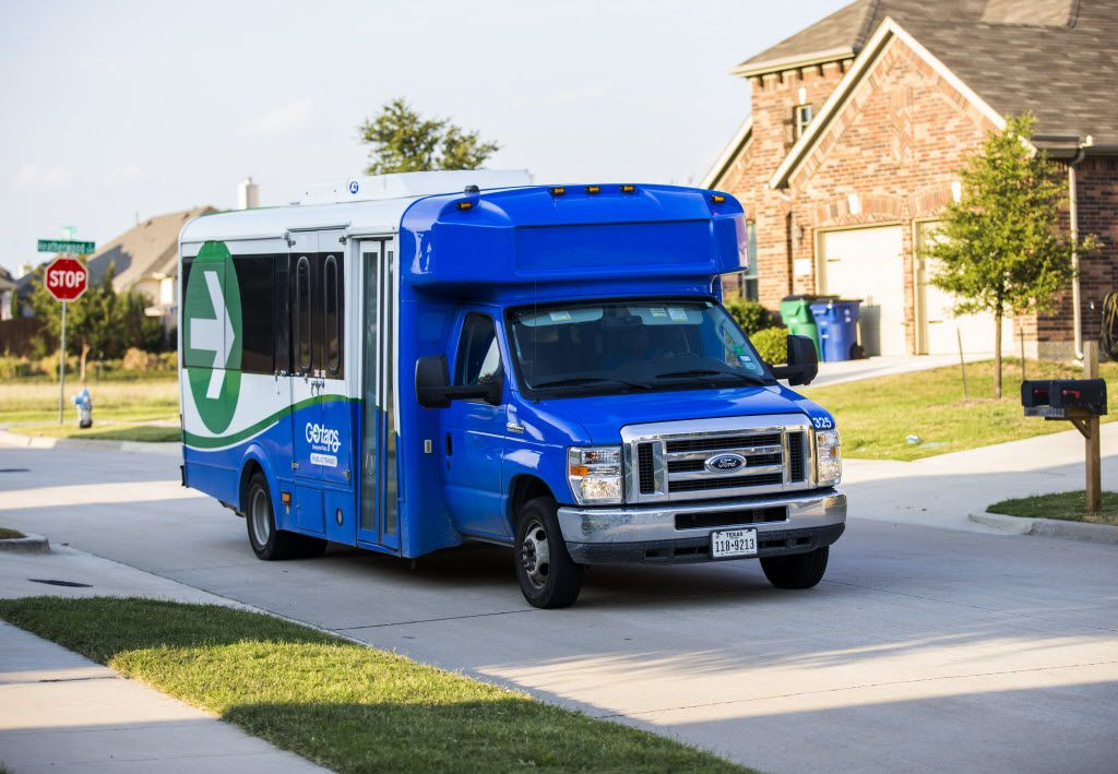 The TAPS Public Transit bus carrying Justin Mann and his guide dog, Garvey, arrives at Mann's home on Oct. 8, 2015. (Ashley Landis/The Dallas Morning News)