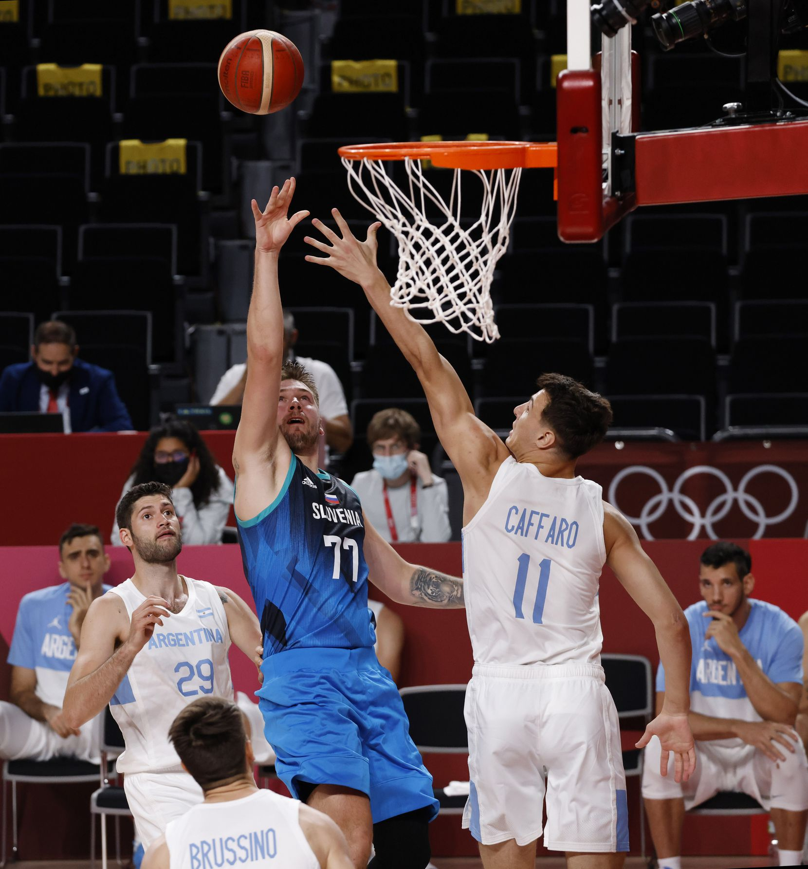 Slovenia's Luka Doncic (77) shoots over Argentina's Francisco Caffaro (11) in the second half of play during the postponed 2020 Tokyo Olympics at Saitama Super Arena on Monday, July 26, 2021, in Saitama, Japan. Slovenia defeated Argentina 118-100. (Vernon Bryant/The Dallas Morning News)