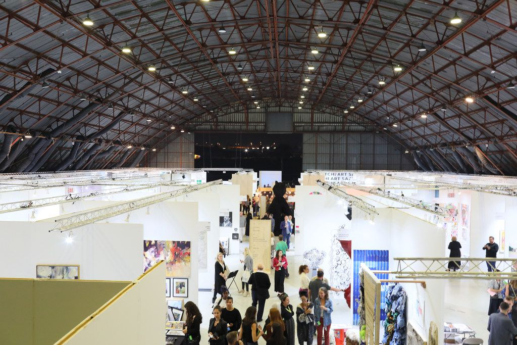 Artists and attendees crowded into the Barker Hangar on Oct. 27, 2018 in Santa Monica, Calif. for the Other Art Fair Los Angeles.