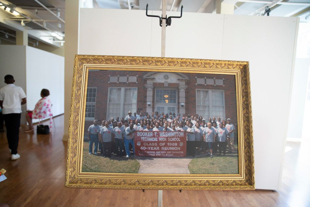 A picture of the Booker T. Washington High School class of 1969 taken 10 years ago at their 40-year reunion sits in a reception hall following ceremonies honoring members of the class of 1969 at Booker T. Washington High School for the Performing and Visual Arts in Dallas on Sunday, June 2, 2019. Fifty years after desegregation separated classmates at Booker T. Washington Technical High School, the class of 1969 turned its reunion Sunday into a belated convocation. Some members of the Class of '69  were unable to graduate from Booker T. Technical High School when a federal desegregation order dispersed them to other Dallas high schools. The ceremony also honored students who would have graduated in 1970 had officials not closed the school.