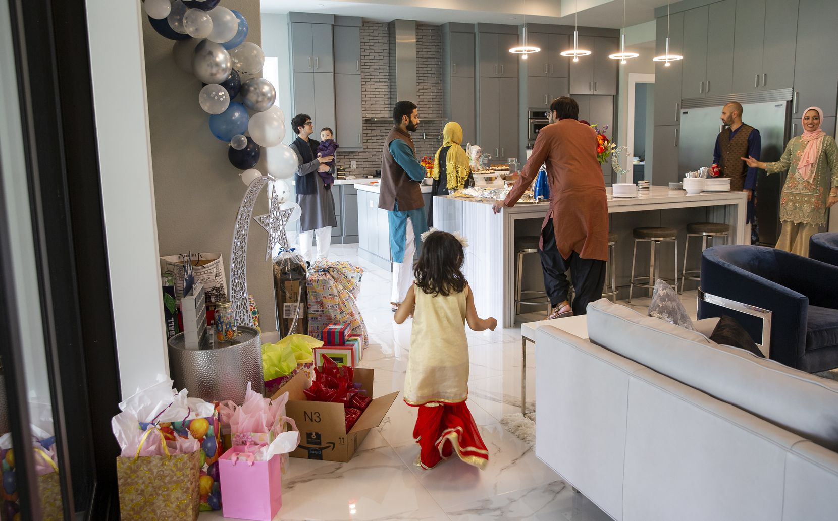 Family members celebrate Eid at Abdul Hayee and Qudsia Nadeem's home on May 24 in Plano.