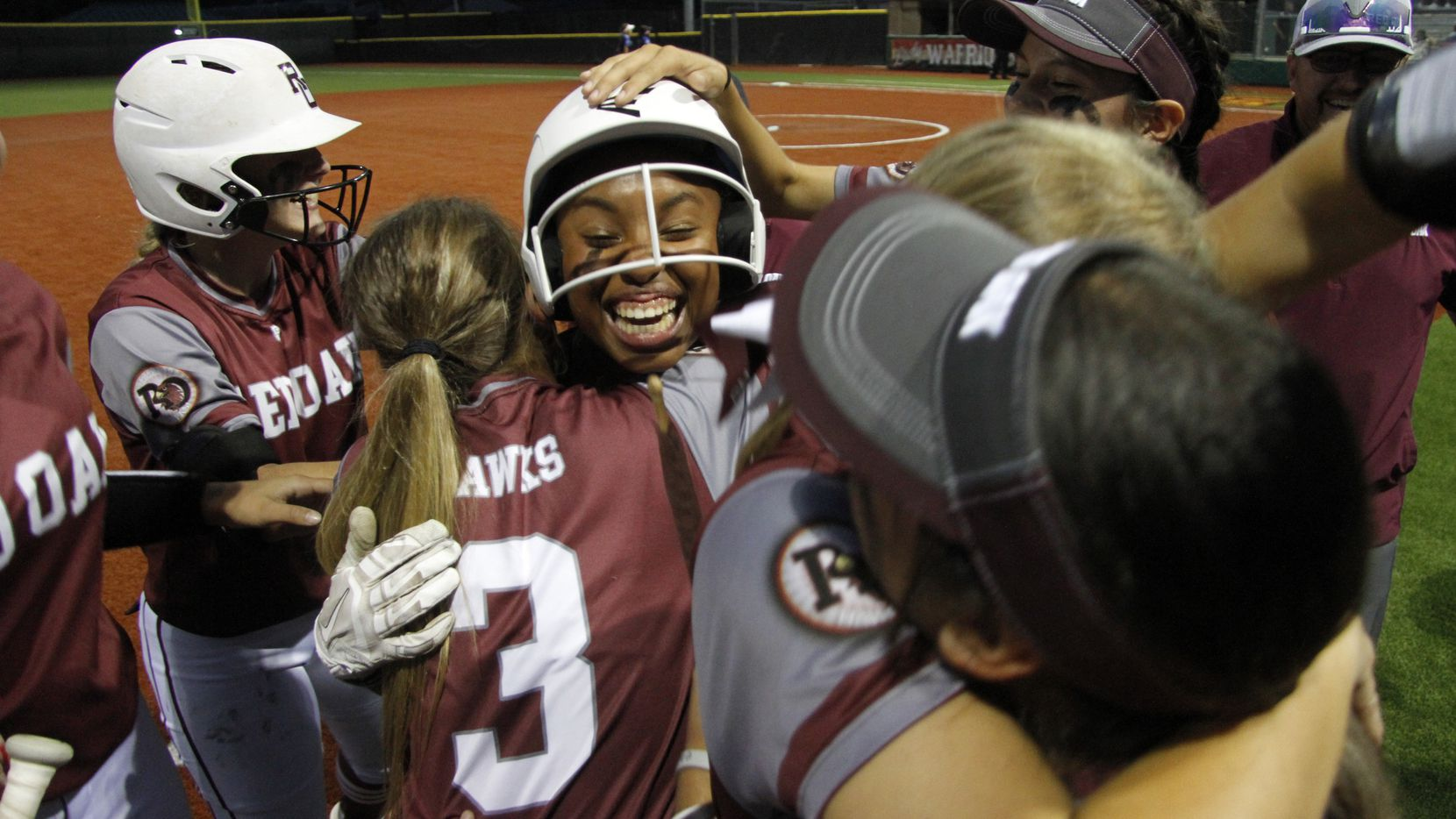 Brianna Evans (center) is mobbed by teammates after her walk-off run-scoring hit in the bottom of the seventh gave Red Oak an 8-7 win over North Forney in Game 1 of a best-of-3 Class 5A bi-district playoff series. (Steve Hamm/Special Contributor)