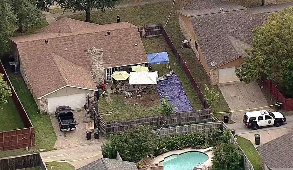 Law enforcement investigators worked Sept. 10 in the backyard of a Plano home where, the day before, a shooting ended in the deaths of nine people, including the gunman.