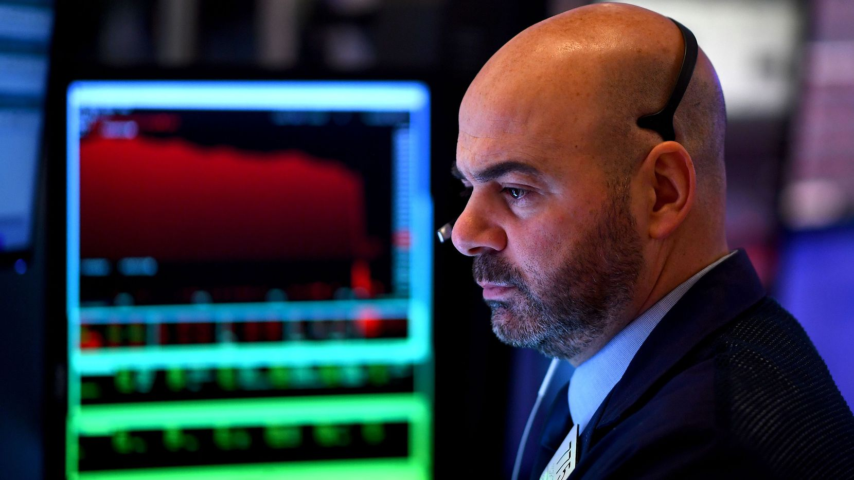 Traders work during the opening bell at the New York Stock Exchange (NYSE) on February 28, 2020 at Wall Street in New York City. - Losses on Wall Street deepened following a bruising open, as global markets were poised to conclude their worst week since 2008 with another rout.