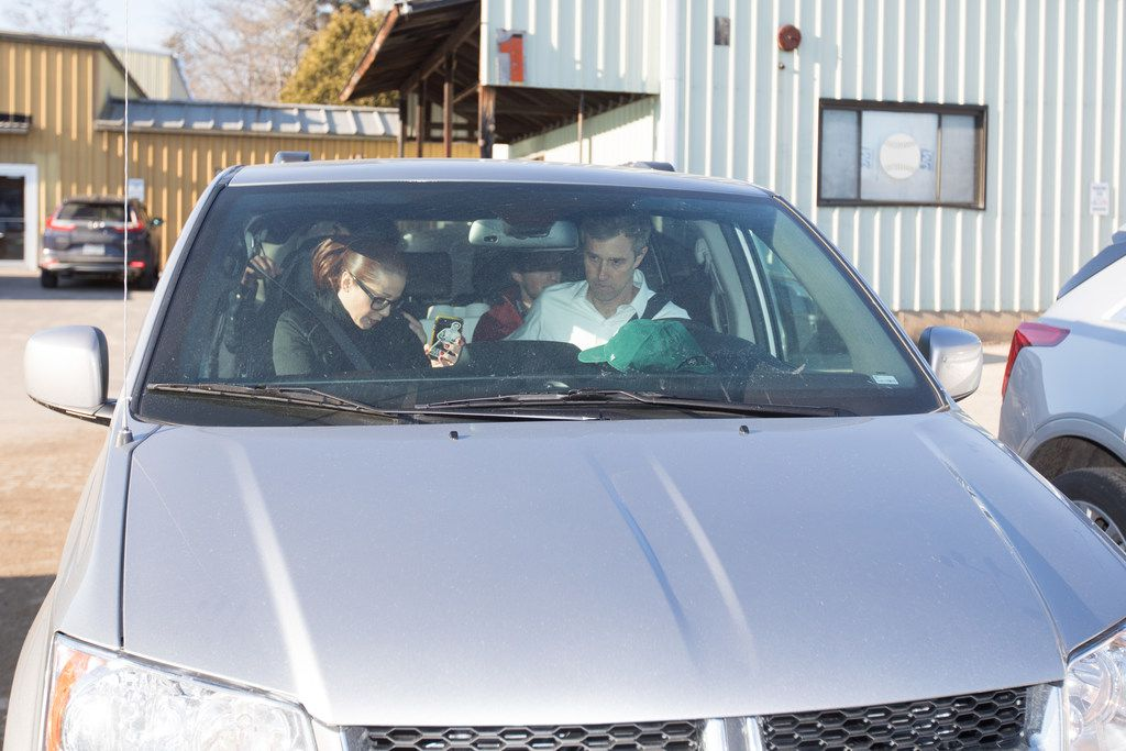 Democratic presidential candidate Beto O'Rourke and staff in a minivan following a campaign stop at Tuckerman Brewing on March 20, 2019 in Conway, New Hampshire.