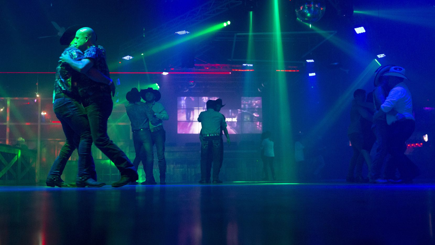 In mid-June, dancers take the floor at Club Los Rieles in Dallas.