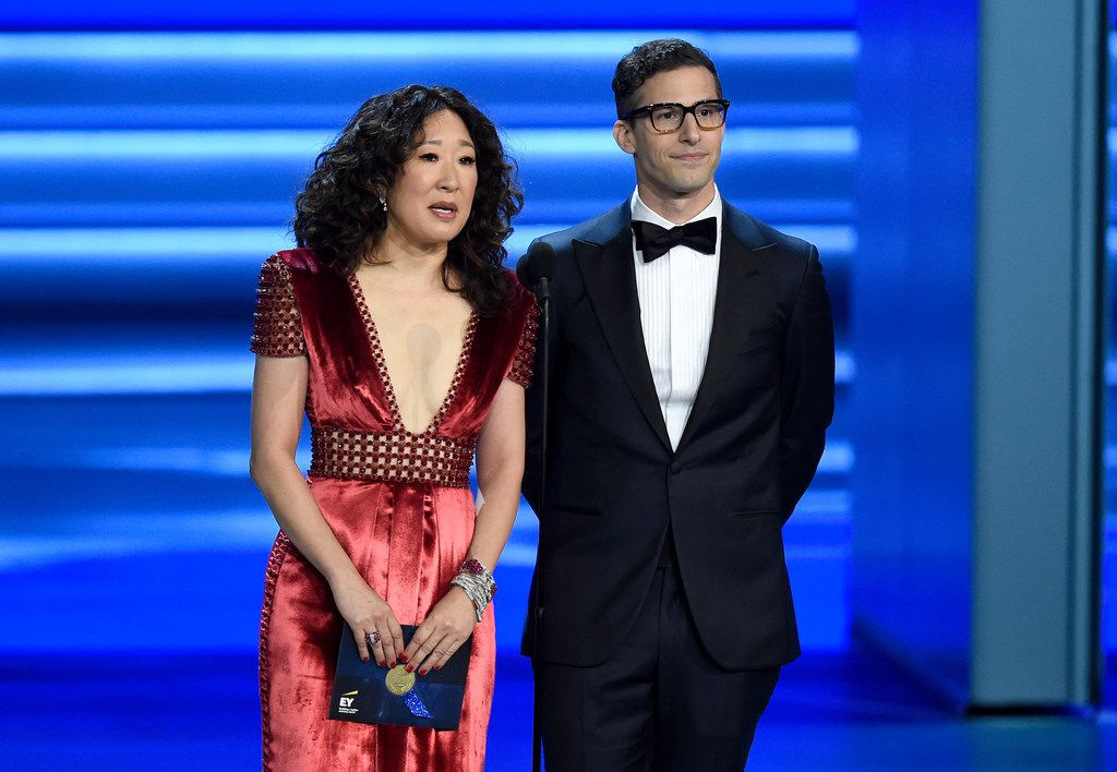 Actress Sandra Oh and comedian-actor Andy Samberg will share Golden Globes hosting duties next month.