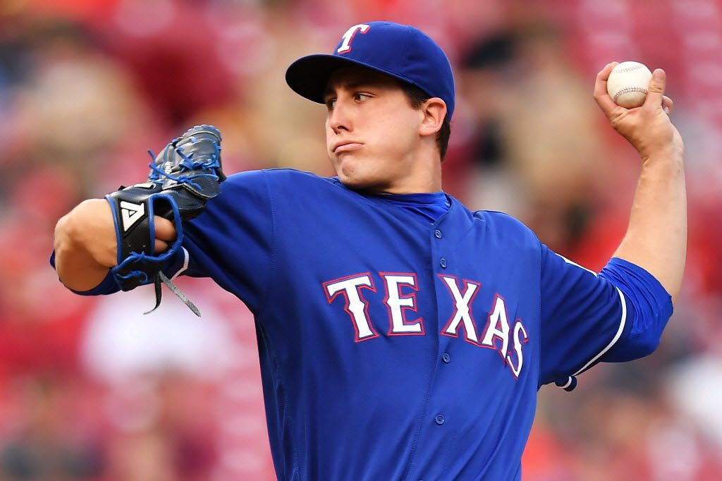 CINCINNATI, OH - AUGUST 23:  Derek Holland #45 of the Texas Rangers pitches in the second inning against the Cincinnati Reds at Great American Ball Park on August 23, 2016 in Cincinnati, Ohio.  (Photo by Jamie Sabau/Getty Images)