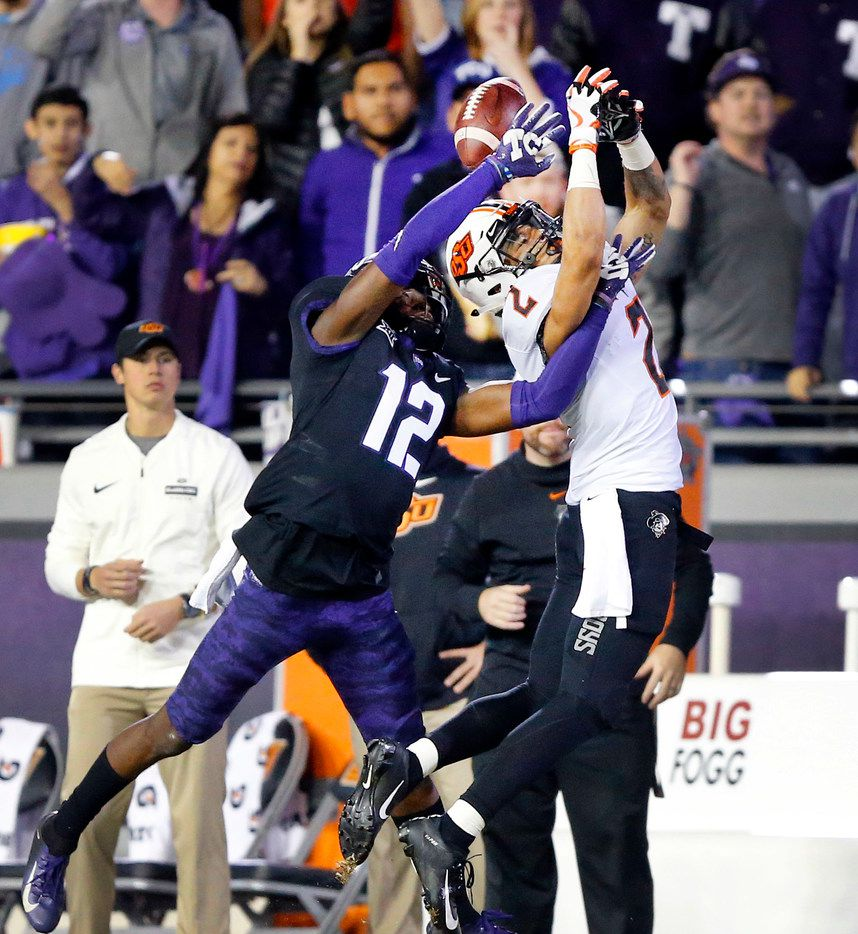 FILE - TCU Horned Frogs cornerback Jeff Gladney (12) keeps Oklahoma State Cowboys wide receiver Tylan Wallace (2) from catching a second half pass at Amon G. Carter Stadium in Fort Worth, Texas, Saturday, November 24, 2018. The Frogs hung onto win, 31-24. (Tom Fox/The Dallas Morning News)