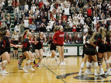The Lovejoy High School bench rushes the team on the floor after completing a sweep in game three as Lovejoy High School defeated Highland Park High School in the Class 5A Region II championship match held at Berkner High School in Richardson on Saturday, November 16, 2019. (Stewart F. House/Special Contributor)