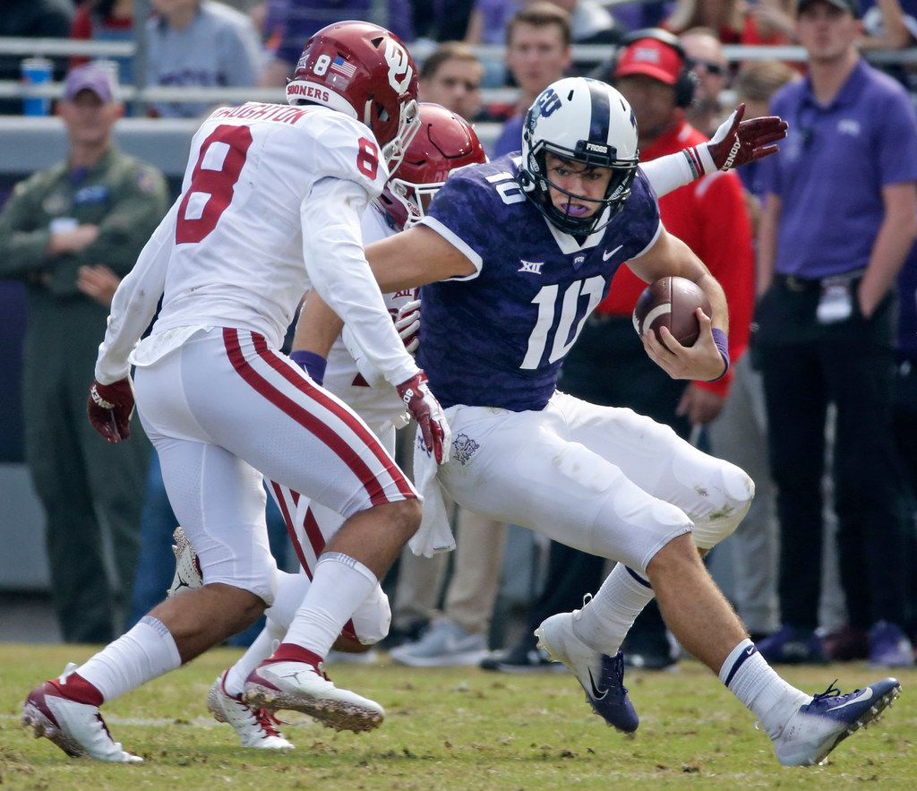 TCU Horned Frogs quarterback Michael Collins (10) looks for running room as Oklahoma Sooners safety Kahlil Haughton (8) closes in for the stop in the fourth quarter during the Oklahoma Sooners vs. the TCU Horned Frogs NCAA football game at Amon G. Carter Stadium in Fort Worth, Texas on Saturday, October 20, 2018. (Louis DeLuca/The Dallas Morning News)